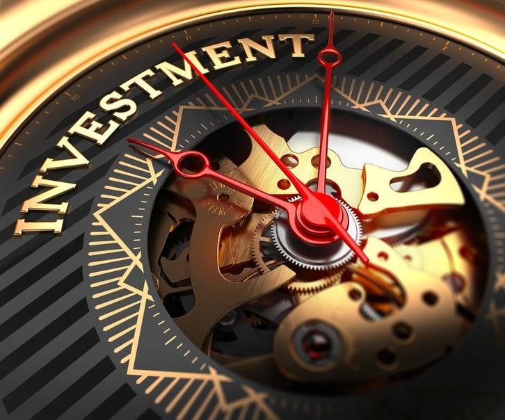 Investment on Black-Golden Watch Face with Watch Mechanism. Full Frame Closeup..jpeg